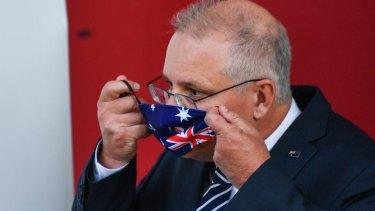 PM Scott Morrison dons an Australian flag mask.