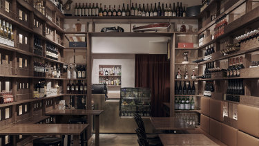 The separate bar has a fuller wine display and an Italian coffee machine.