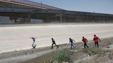 Migrants cross the Rio Bravo illegally to surrender to the American authorities, on the US - Mexico border between Ciudad Juarez and El Paso.