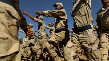 Iraq army recruits march during training at Camp Taji in Iraq. Australia has contributed resources to train Iraqis and help stem the influence of Islamic State as part of the coalition.