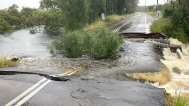 Flooding damages the road at Foreshore Drive in Port Stephens.