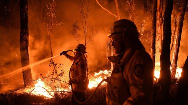NSW RFS firefighters work through the night.