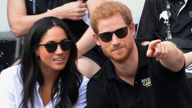 Prince Harry and his then girlfriend Meghan Markle attend the wheelchair tennis competition during the Invictus Games in Toronto last year.