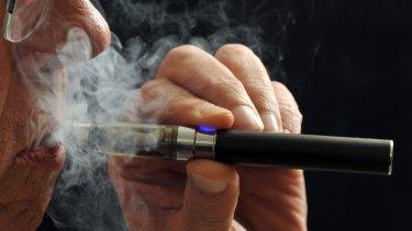 Vaping from an e-cigarette.