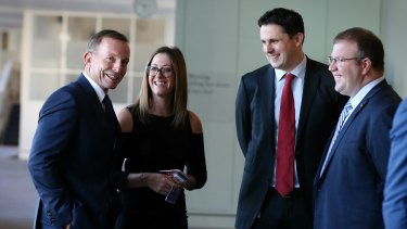 Liberal Party federal director Andrew Hirst (centre), with former prime minister Tony Abbott, is being credited with the Coalition's election win.