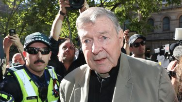 Cardinal George Pell arrives at County Court in Melbourne.