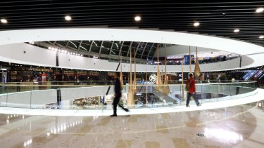 Shoppers at the Tongzhou Wanda Plaza shopping centre, operated by Dalian Wanda Group, in Beijing.