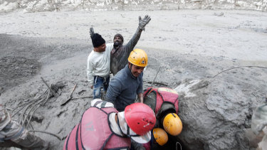 A man after being rescued from the flood in northern India.