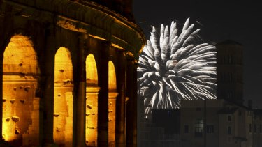 Fireworks explode in the sky next to Rome's Colosseum during New Year's celebrations, in Rome.