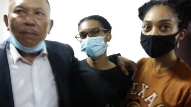 Kristen Antoinette Gray, centre, her partner Saundra Michelle Alexander, right, and lawyer Erwin Siregar arrive at the immigration office for questioning, in Denpasar, Bali, on Tuesday.