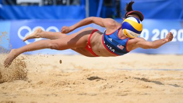 USA's Sarah Sponcil #2 dives to return the ball against Latvia at the beach volleyball preliminaries on Monday.
