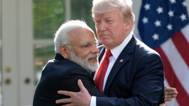 President Trump and Indian Prime Minister Narendra Modi hug outside the White House.