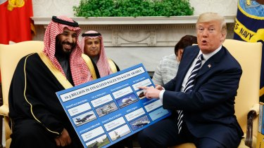 President Donald Trump shows a chart highlighting arms sales to Saudi Arabia during a meeting with Saudi Crown Prince Mohammed bin Salman in the Oval Office in 2018.