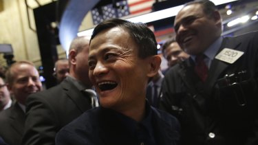 In happier days: Billionaire Jack Ma, chairman of Alibaba Group, on  the floor of the New York Stock Exchange at the Chinese company's listing in 2014.
