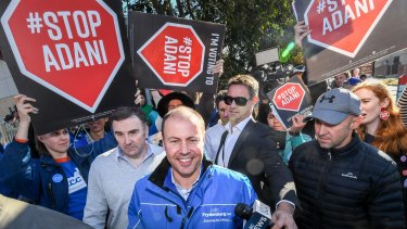 Anti-Adani campaigners surround Federal Treasurer Josh Frydenberg in his Kooyong electorate to protest against the Carmichael coal mine.