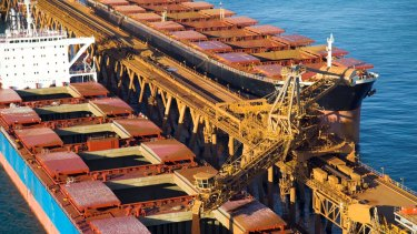 A ship being loaded with iron ore from a Rio Tinto mine in the Pilbara.