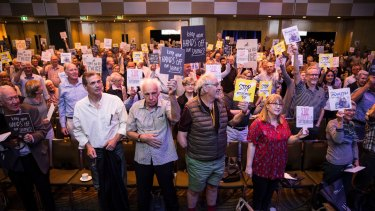 Investors at the Wilson Asset Management event protesting against Labor's policy.