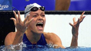 Dutch swimmer Inge de Bruijn celebrates after winning the gold medal in the women's 100m butterfly.