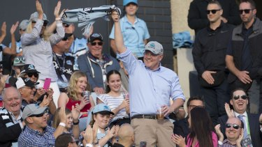 Prime Minister Scott Morrison waves to the crowd during the Round 10 NRL match between the Cronulla Sharks and the Manly Sea Eagles in 2019.