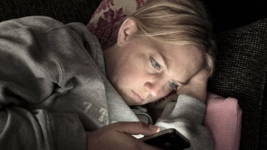 More than a quarter of parents say they use their mobile devices as they go to bed.