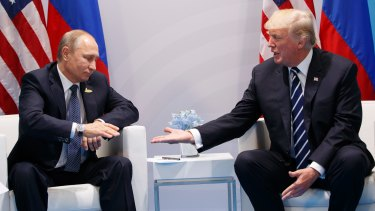President Donald Trump reaches to shakes hands with Russian President Vladimir Putin at the 2017 G20 summit.