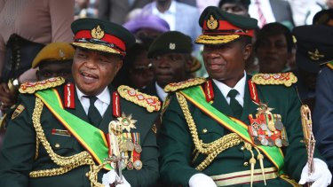 Army General Constantino Chiwenga, left, chats with General Valerio Sibanda during the presidential inauguration ceremony last year.
