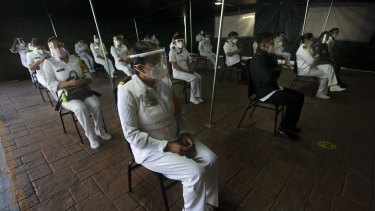 Mexican army health workers wait to be vaccinated against COVID-19 at the Central Military Hospital in Mexico City.
