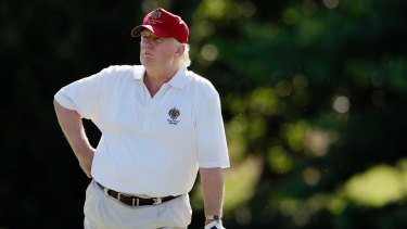 Donald Trump on a golf course.