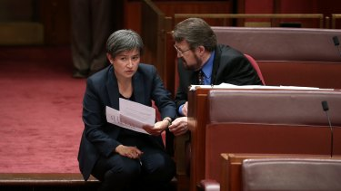 Senator Penny Wong and Senator Derryn Hinch during debate on the ABCC bill in the Senate at Parliament House in 2016.
