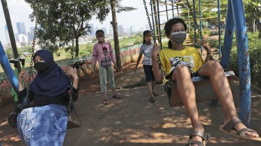 Children wear face masks as a precaution against the spread of coronavirus in Jakarta, Indonesia.