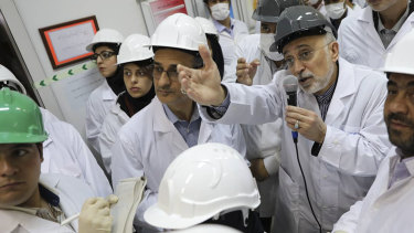 Ali Akbar Salehi, head of Iran's Atomic Energy Organisation, speaks with media while visiting Natanz enrichment facility in central Iran.