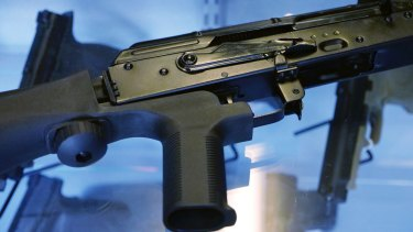 A device called a bump stock is attached to a semi-automatic rifle at the Gun Vault store and shooting range in South Jordan, Utah. The controversial device was used in the Las Vegas shooting, allowing a semi-automatic rifle to mimic a fully automatic firearm.
