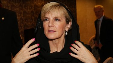 Julie Bishop replaces her head scarf after a press conference with the Australian media in Tehran in 2015.