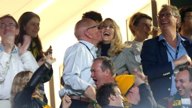 Rupert Murdoch and fourth wife Jerry Hall celebrate with a kiss in the stands during the Rugby World Cup in 2015.