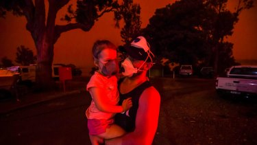 The sky in Mallacoota turned blood red on January 4, when a south-westerly wind change fanned flames. Mike and his daughter Elsie were still trapped in the tiny coastal town five days after the first fire ripped through.
