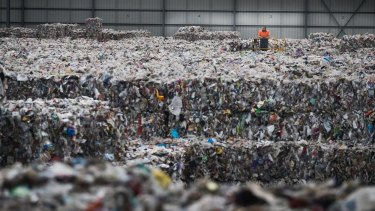 SKM recycling has left left more than 10,000 tonnes of low-grade plastic recycling at a warehouse in Derrimut that will cost millions to dispose of.