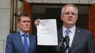 Attorney-General Christian Porter and Prime Minister Scott Morrison with the proposed bill.