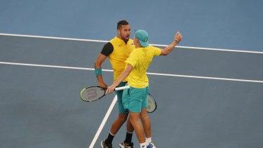 Australia's Alex De Minaur and Nick Kyrgios celebrate after winning the decisive doubles rubber against Great Britain.