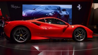 Authorities allege the man bought a Ferrari among other luxury cars with funds aimed at helping small businesses survive the COVID pandemic.