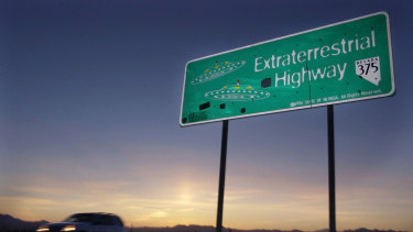 A vehicle moves along the Extraterrestrial Highway near Rachel, Nevada.