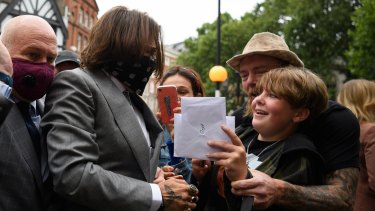 Actor Johnny Depp speaks to supporters and well-wishers as he arrives at the Royal Courts of Justice.