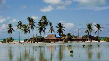 Flooded homes in the village of Taborio on the Tarawa atoll in Kiribati