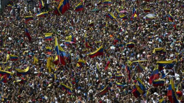 Anti-government protesters take part in a demonstration demanding the resignation of President Nicolas Maduro in Caracas on Saturday.