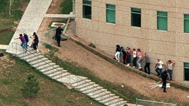 Police officers outside Columbine High School during the shooting rampage in 1999 in which 12 students and a teacher were killed.