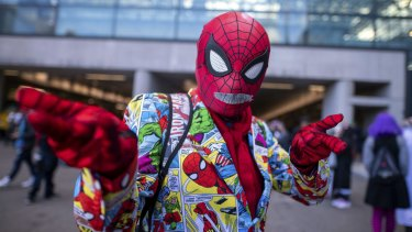 A fan dressed as Spider-Man poses during New York Comic Con.