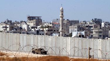 An Israeli army vehicle patrols along Israel's separation barrier.