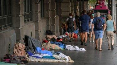 Homeless people outside Melbourne's Flinders Street Station in 2016
