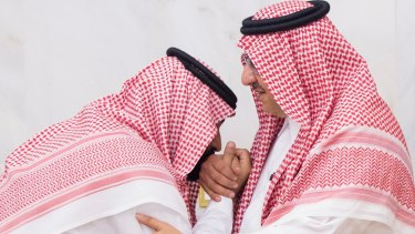 A newly appointed Mohammed bin Salman, left, kisses the hand of Prince Mohammed bin Nayef at the royal palace in Mecca, Saudi Arabi in 2017.