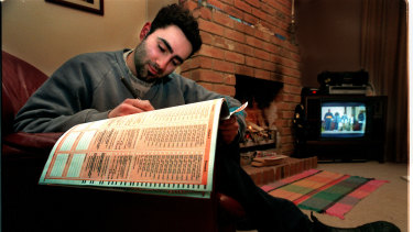 Filling out the census in the year 2000.