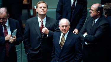 "Treasurer Peter Costello and Prime Minister John Howard in Parliament. Howard famously ruled out introducing the GST, declaring ""never ever""."